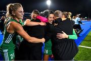 3 November 2019; Ireland players Chloe Watkins, left, Lizzie Colvin and Anna O'Flanagan celebrate with former Ireland international Kate Dillon and Colin Stewart after the FIH Women's Olympic Qualifier match between Ireland and Canada at Energia Park in Dublin. Photo by Brendan Moran/Sportsfile