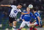 8 November 2019; Jordan Flores of Dundalk in action against Shayne Lavery and Stephen Fallon of Linfield during the Unite the Union Champions Cup first leg match between Linfield and Dundalk at the National Football Stadium at Windsor Park in Belfast. Photo by Oliver McVeigh/Sportsfile