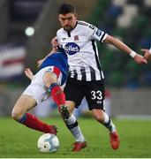 8 November 2019; Dean Jarvis of Dundalk in action against Stephen Fallon of Linfield during the Unite the Union Champions Cup first leg match between Linfield and Dundalk at the National Football Stadium at Windsor Park in Belfast. Photo by Oliver McVeigh/Sportsfile
