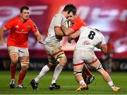 9 November 2019; James Cronin of Munster is tackled by Sam Carter, left, and Nick Timoney of Ulster during the Guinness PRO14 Round 6 match between Munster and Ulster at Thomond Park in Limerick. Photo by Brendan Moran/Sportsfile