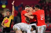 9 November 2019; Andrew Conway of Munster celebrates after scoring his side's third try with team-mates Jack O'Donoghue and Conor Murray during the Guinness PRO14 Round 6 match between Munster and Ulster at Thomond Park in Limerick. Photo by Brendan Moran/Sportsfile
