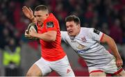 9 November 2019; Andrew Conway of Munster beats the tackle of Jacob Stockdale of Ulster on the way to scoring his side's third try during the Guinness PRO14 Round 6 match between Munster and Ulster at Thomond Park in Limerick. Photo by Brendan Moran/Sportsfile