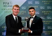 9 November 2019; PFA Ireland Young Player of the Year Daniel Mandroiu of Bohemian FC is presented with his award by Republic of Ireland U21 manager Stephen Kenny during the PFA Ireland Awards 2019 at The Marker Hotel in Dublin. Photo by Seb Daly/Sportsfile