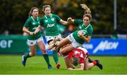 10 November 2019; Eimear Considine of Ireland is tackled by Alecs Donovan, left, and Paige Randall of Wales during the Women's Rugby International match between Ireland and Wales at the UCD Bowl in Dublin. Photo by David Fitzgerald/Sportsfile