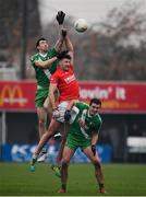 10 November 2019; Eoghan Ruth of Éire Óg in action against Caoimhín McDonnell, left, and Con Kavanagh of Sarsfields during the AIB Leinster GAA Football Senior Club Championship Quarter-Final match between Éire Óg and Sarsfields at Netwatch Cullen Park in Carlow. Photo by Sam Barnes/Sportsfile