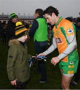 10 November 2019; Michael Farragher of Corofin hands his gloves to a supporter following the AIB Connacht GAA Football Senior Club Football Championship Semi-Final match between Corofin and Ballintubber St Enda's at Tuam Stadium in Tuam, Galway. Photo by Ramsey Cardy/Sportsfile