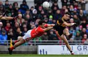 10 November 2019; Tony Brosnan of Dr. Crokes kicks a point despite the best efforts of Jack Sherwood of East Kerry during the Kerry County Senior Club Football Championship Final match between East Kerry and Dr. Crokes at Austin Stack Park in Tralee, Kerry. Photo by Brendan Moran/Sportsfile
