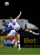 11 November 2019; Daniel Cleary of Dundalk in action against Andrew Waterworth of Linfield during the Unite the Union Champions Cup Second Leg match between Dundalk and Linfield at Oriel Park in Dundalk, Louth. Photo by Eóin Noonan/Sportsfile