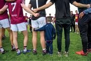 9 June 2019;  The inner circles. Senan Lawlor, aged three from Rosemount, joins a relaxed Westmeath team huddle following their routine qualifier win over Waterford United . Photo by Harry Murphy/Sportsfile
