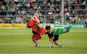"19 May 2019; Sisters Mairéad Purcell, aged three, and five-year-old Clodagh Purcell, from the CBS Pipe Band in Limerick, fly the flags in the Gaelic Grounds. But Cork are marching to a different tune and give the All-Ireland champions a sharp wake-up call  Photo by Diarmuid Greene/Sportsfile This image may be reproduced free of charge when used in conjunction with a review of the book ""A Season of Sundays 2019"". All other usage © SPORTSFILE"