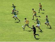 "14 July 2019; Not for the first time in recent seasons Ryan McHugh leads the charge in a Donegal counter-attack. Where he goes, others follow. Here, McHugh's team-mates Michael Langan, left, and Stephen McMenamin are running support lines while the Meath players racing to get back into position are, from left, Shane McEntee, Bryan Menton, Shane Walsh and James McEntee. And referee Conor Lane is right up with the break too. It's Meath's third defeat to Donegal this year but this is the most damaging. Photo by Daire Brennan/Sportsfile This image may be reproduced free of charge when used in conjunction with a review of the book ""A Season of Sundays 2019"". All other usage © SPORTSFILE"