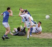 "26 May 2019; Swinging a boot at it. Longford's David McGivney watches Michael Quinn get his boot to the ball ahead of Kildare full back David Hyland to finish to the net in extra-time of a thrilling draw, with goalkeeper Mark Donnellan and Eoin Doyle powerless in a chaotic goalmouth. Photo by Ray McManus/Sportsfile. This image may be reproduced free of charge when used in conjunction with a review of the book ""A Season of Sundays 2019"". All other usage © SPORTSFILE"