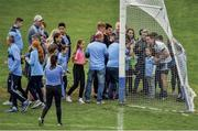 "25 May 2019; Backstop. Dublin goalkeeper Stephen Cluxton is heading deeper into his own goal obliging supporters for selfies after his team's 26-point demolition job on Louth.  Photo by Ray McManus/Sportsfile. This image may be reproduced free of charge when used in conjunction with a review of the book ""A Season of Sundays 2019"". All other usage © SPORTSFILE"