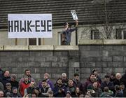 "19 January 2019; Eyes like a hawk. A fan sets up an improvised Hawk-Eye, complete with Tá sign. Is anyone in the crowd in Enniscorthy taken in? Níl. In fact, they were enthralled by a fiery Walsh Cup final that featured four red cards and a 13-point haul for Joe Canning. Photo by Piaras Ó Mídheach/Sportsfile. This image may be reproduced free of charge when used in conjunction with a review of the book ""A Season of Sundays 2019"". All other usage © SPORTSFILE"