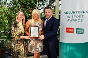 12 November 2019; Sharon Galvin of Limerick Belles FC, Co. Limerick, is presented with their award by Mary O'Connor, CEO of the Federation of Irish Sport, and Richard Gernon, Regional Manager EBS, during the Volunteers in Sport Awards presented by Federation of Irish Sport with EBS at Farmleigh House in Phoenix Park, Dublin. Photo by Sam Barnes/Sportsfile