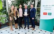 12 November 2019; Ned Bolyle from Monaghan, second from right, is presented with their award by Mary O'Connor, CEO of the Federation of Irish Sport, left, and Richard Gernon, Regional Manager EBS, right, during the Volunteers in Sport Awards presented by Federation of Irish Sport with EBS at Farmleigh House in Phoenix Park, Dublin. Photo by Sam Barnes/Sportsfile
