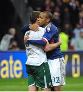 18 November 2009; Richard Dunne, Republic of Ireland, with Thierry Henry, France, after the game. FIFA 2010 World Cup Qualifying Play-off 2nd Leg, Republic of Ireland v France, Stade de France, Saint-Denis, Paris, France. Picture credit: Stephen McCarthy / SPORTSFILE