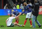 18 November 2009; Richard Dunne, Republic of Ireland, with Nicolas Anelka, France, after the game. FIFA 2010 World Cup Qualifying Play-off 2nd Leg, Republic of Ireland v France, Stade de France, Saint-Denis, Paris, France. Picture credit: Stephen McCarthy / SPORTSFILE