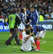 18 November 2009; Richard Dunne, Republic of Ireland, with Patrice Evra, France, after the game. FIFA 2010 World Cup Qualifying Play-off 2nd Leg, Republic of Ireland v France, Stade de France, Saint-Denis, Paris, France. Picture credit: Stephen McCarthy / SPORTSFILE