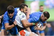 16 November 2019; Rory O'Loughlin of Leinster supported by Garry Ringrose, left, is tackled by Dewaldt Duvenage of Benetton  during the Heineken Champions Cup Pool 1 Round 1 match between Leinster and Benetton at the RDS Arena in Dublin. Photo by Ramsey Cardy/Sportsfile