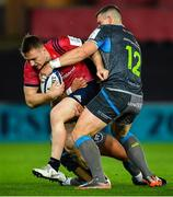 16 November 2019; Rory Scannell of Munster is tackled by Scott Williams, right, and Tiaan Thomas-Wheeler of Ospreys during the Heineken Champions Cup Pool 4 Round 1 match between Ospreys and Munster at Liberty Stadium in Swansea, Wales. Photo by Seb Daly/Sportsfile