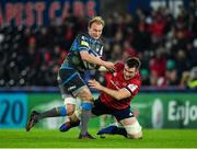 16 November 2019; Luke Price of Ospreys is tackled by Peter O'Mahony of Munster during the Heineken Champions Cup Pool 4 Round 1 match between Ospreys and Munster at Liberty Stadium in Swansea, Wales. Photo by Seb Daly/Sportsfile