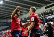 16 November 2019; Keith Earls of Munster, right, is congratulated by team-mate Tyler Bleyendaal after scoring his side's second try during the Heineken Champions Cup Pool 4 Round 1 match between Ospreys and Munster at Liberty Stadium in Swansea, Wales. Photo by Seb Daly/Sportsfile