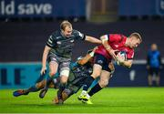 16 November 2019; Keith Earls of Munster is tackled by James Hook, centre, and Luke Price of Ospreys during the Heineken Champions Cup Pool 4 Round 1 match between Ospreys and Munster at Liberty Stadium in Swansea, Wales. Photo by Seb Daly/Sportsfile