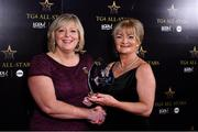 16 November 2019; Breda Kelly, right, accepts the Score of the Year award on behalf of her daughter, Mayo footballer, Niamh Kelly, from Marie Hickey, President, LGFA, during the TG4 All-Ireland Ladies Football All Stars Awards banquet, in association with Lidl at the Citywest Hotel in Saggart, Dublin. Photo by Brendan Moran/Sportsfile