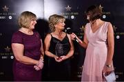 16 November 2019; Gráinne McElwain, right, interviews Breda Kelly, after she accepted the Score of the Year award on behalf of her daughter, Mayo footballer, Niamh Kelly, from Marie Hickey, President, LGFA, left, during the TG4 All-Ireland Ladies Football All Stars Awards banquet, in association with Lidl at the Citywest Hotel in Saggart, Dublin. Photo by Brendan Moran/Sportsfile