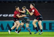 16 November 2019; Kieran Williams of Ospreys is tackled by Rory Scannell, left, and Chris Farrell of Munster during the Heineken Champions Cup Pool 4 Round 1 match between Ospreys and Munster at Liberty Stadium in Swansea, Wales. Photo by Seb Daly/Sportsfile
