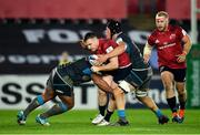 16 November 2019; Rory Scannell of Munster is tackled by Ma'afu Fia, left, and Lloyd Ashley of Ospreys during the Heineken Champions Cup Pool 4 Round 1 match between Ospreys and Munster at Liberty Stadium in Swansea, Wales. Photo by Seb Daly/Sportsfile