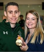 16 November 2019; T13 100m gold medalist Jason Smyth, from Derry, is greeted by his wife Elise, at Dublin Airport on Team Ireland's return from the World Para Athletics Championships 2019, held in Dubai. Photo by Stephen McCarthy/Sportsfile