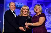 16 November 2019; Joan McEvoy, on behalf of her daughter Niamh McEvoy of Dublin, is presented with the TG4 All Star award by Ard Stiúrthóir TG4, Alan Esslemont and President of LGFA Marie Hickey during the TG4 All-Ireland Ladies Football All Stars Awards banquet, in association with Lidl, at the Citywest Hotel in Saggart, Dublin. Photo by Brendan Moran/Sportsfile