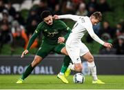 14 November 2019; Callum McCowatt of New Zealand is tackled by Derrick Williams of Republic of Ireland during the International Friendly match between Republic of Ireland and New Zealand at the Aviva Stadium in Dublin. Photo by Stephen McCarthy/Sportsfile