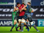 16 November 2019; CJ Stander of Munster is tackled by Bradley Davies, right, and Olly Cracknell of Ospreys during the Heineken Champions Cup Pool 4 Round 1 match between Ospreys and Munster at Liberty Stadium in Swansea, Wales. Photo by Seb Daly/Sportsfile
