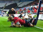 16 November 2019; Keith Earls of Munster dives over to score his side's second try, despite the tackle of Hanno Dirksen of Ospreys, during the Heineken Champions Cup Pool 4 Round 1 match between Ospreys and Munster at Liberty Stadium in Swansea, Wales. Photo by Seb Daly/Sportsfile