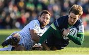 17 November 2019; John Porch of Connacht is tackled by Aaron Cruden of Montpellier during the Heineken Champions Cup Pool 5 Round 1 match between Connacht and Montpellier at The Sportsground in Galway. Photo by Ramsey Cardy/Sportsfile