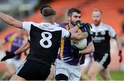 17 November 2019; Declan Cassidy of Derrygonnelly in action against Aaron Morgan of Kilcoo during the AIB Ulster GAA Football Senior Club Championship semi-final match between Kilcoo and Derrygonnelly at the Athletic Grounds in Armagh. Photo by Oliver McVeigh/Sportsfile