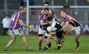 17 November 2019; Anthony Morgan of Kilcoo in action against Kevin Cassidy, Declan Cassidy and Ryan Jones of Derrygonnelly during the AIB Ulster GAA Football Senior Club Championship semi-final match between Kilcoo and Derrygonnelly at the Athletic Grounds in Armagh. Photo by Oliver McVeigh/Sportsfile