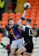 17 November 2019; Gavin McGovern of Derrygonnelly in action against Ryan McAvoy of Kilcoo during the AIB Ulster GAA Football Senior Club Championship semi-final match between Kilcoo and Derrygonnelly at the Athletic Grounds in Armagh. Photo by Oliver McVeigh/Sportsfile
