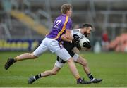 17 November 2019; Conor Lavery of Kilcoo in action against Jack Love of Derrygonnelly during the AIB Ulster GAA Football Senior Club Championship semi-final match between Kilcoo and Derrygonnelly at the Athletic Grounds in Armagh. Photo by Oliver McVeigh/Sportsfile