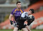 17 November 2019; Eugene Branagan of Kilcoo in action against Ryan Jones of Derrygonnelly during the AIB Ulster GAA Football Senior Club Championship semi-final match between Kilcoo and Derrygonnelly at the Athletic Grounds in Armagh. Photo by Oliver McVeigh/Sportsfile