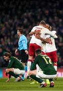 18 November 2019; Jens Stryger Larsen celebrates with, Henrik Dalsgaard of Denmark, while Ciaran Clark of Republic of Ireland is dejected during the UEFA EURO2020 Qualifier match between Republic of Ireland and Denmark at the Aviva Stadium in Dublin. Photo by Harry Murphy/Sportsfile