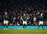 18 November 2019; Dejected Republic of Ireland players, from left, Alan Browne, Enda Stevens and James McClean during the UEFA EURO2020 Qualifier match between Republic of Ireland and Denmark at the Aviva Stadium in Dublin. Photo by Harry Murphy/Sportsfile