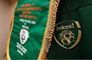 19 November 2019; The match pennant hangs in front of the jersey assigned to Republic of Ireland captain Jayson Molumby in their dressing room prior to the UEFA European U21 Championship Qualifier match between Republic of Ireland and Sweden at Tallaght Stadium in Tallaght, Dublin. Photo by Stephen McCarthy/Sportsfile