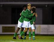 19 November 2019; Kevin Zeffi of Republic of Ireland, right, is congratulated by team-mates Gideon Tetteh, left, and Caden McLaughlin after scoring his side's first goal during the U15 International Friendly match between Republic of Ireland and Poland at Eamonn Deacy Park in Galway. Photo by Seb Daly/Sportsfile