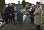 21 November 2019; Uachtarán Cumann Lúthchleas Gael John Horan unveils the headstone of Patrick O'Dowd with family members of the deceased during the unveiling of headstones on the graves of Jerome O'Leary, 10, Michael Feery, 40, and Patrick O'Dowd, 57, who are among the 14 people killed at Croke Park on this day 99 years ago on what became known as Bloody Sunday. These unveilings complete the list of seven Bloody Sunday victims who until recently had all been buried in unmarked graves at different locations at Glasnevin Cemetery in Dublin. Photo by Matt Browne/Sportsfile