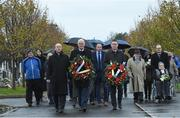 21 November 2019; Uachtarán Cumann Lúthchleas Gael John Horan, centre, Monsignor Eoin Thynne, left, and Ard Stiúrthóir of the GAA Tom Ryan with relatives of the deceased at the unveiling of headstones on the graves of Jerome O'Leary, 10, Michael Feery, 40, and Patrick O'Dowd, 57, who are among the 14 people killed at Croke Park on this day 99 years ago on what became known as Bloody Sunday. These unveilings complete the list of seven Bloody Sunday victims who until recently had all been buried in unmarked graves at different locations at Glasnevin Cemetery in Dublin. Photo by Matt Browne/Sportsfile