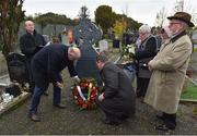 21 November 2019; Uachtarán Cumann Lúthchleas Gael John Horan, left, and Ard Stiúrthóir of the GAA Tom Ryan place a wreath at the headstone of Patrick O'Dowd during the unveiling of headstones on the graves of Jerome O'Leary, 10, Michael Feery, 40, and Patrick O'Dowd, 57, who are among the 14 people killed at Croke Park on this day 99 years ago on what became known as Bloody Sunday. These unveilings complete the list of seven Bloody Sunday victims who until recently had all been buried in unmarked graves at different locations at Glasnevin Cemetery in Dublin. Photo by Matt Browne/Sportsfile